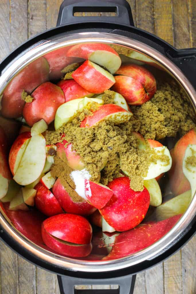image of ingredients in an instant pot ready to be cooked down into apple butter