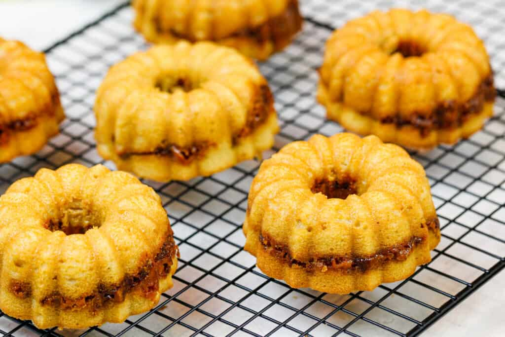 image of peanut butter mini bundt cakes baked with a butterfinger ripple through the middle