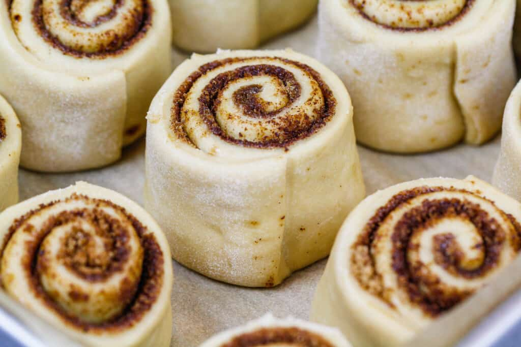 image of coffee cinnamon rolls in a pan ready to be proofed