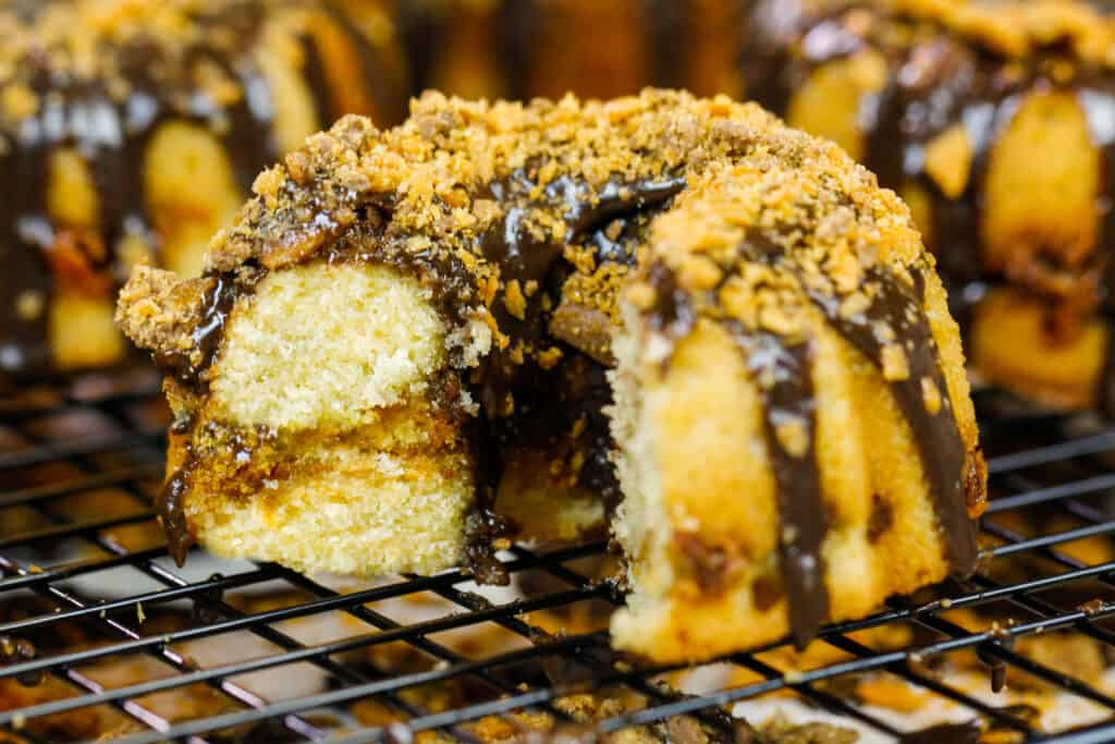 image of a mini butterfinger bundt cake that's been cut into to show it's peanut butterfinger ripple