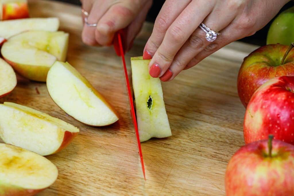 image of apples being cut into quarters to make apple butter