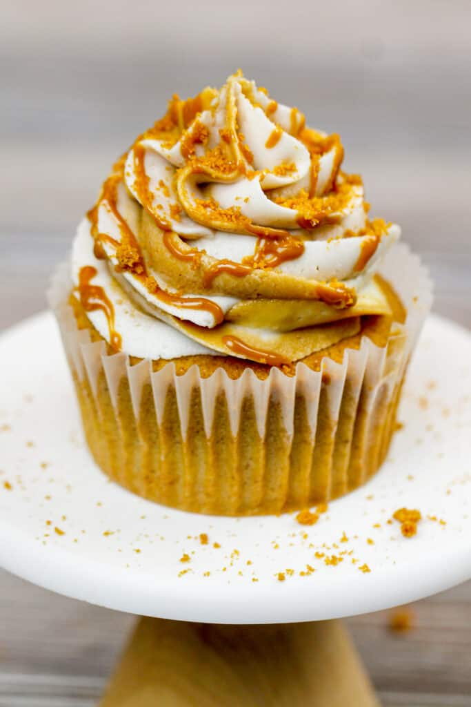 image of a Biscoff cookie butter cupcake drizzled with cookie butter