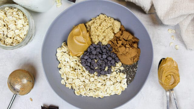image of ingredients in a bowl to make chocolate overnight oats