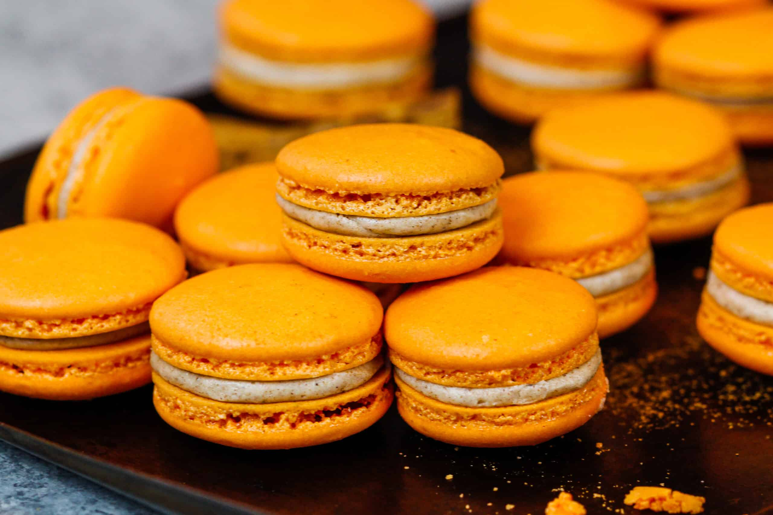 image of pumpkin macarons with a spiced buttercream and pumpkin pie filling