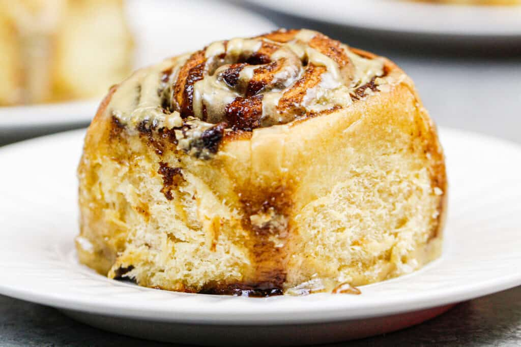 image of a coffee flavored cinnamon roll on a plate