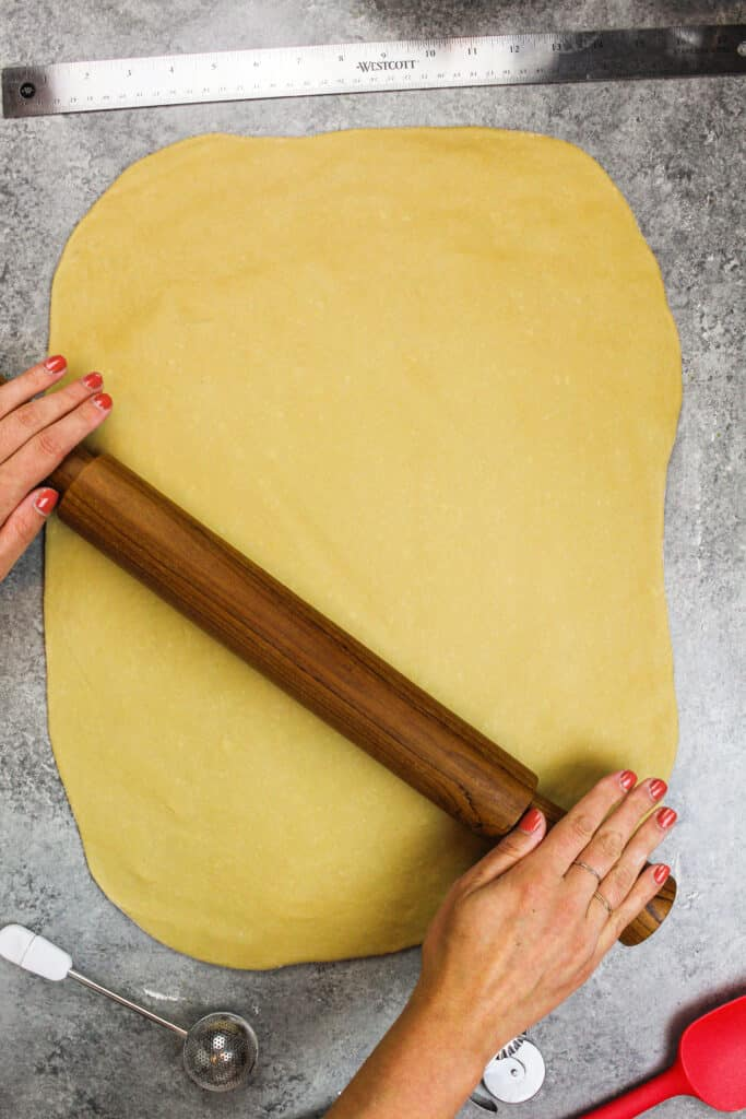 image of coffee flavored dough being rolled out on a floured surface.
