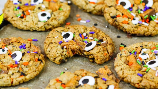 image of monster peanut butter cookies made with butterfinger and candy eyes