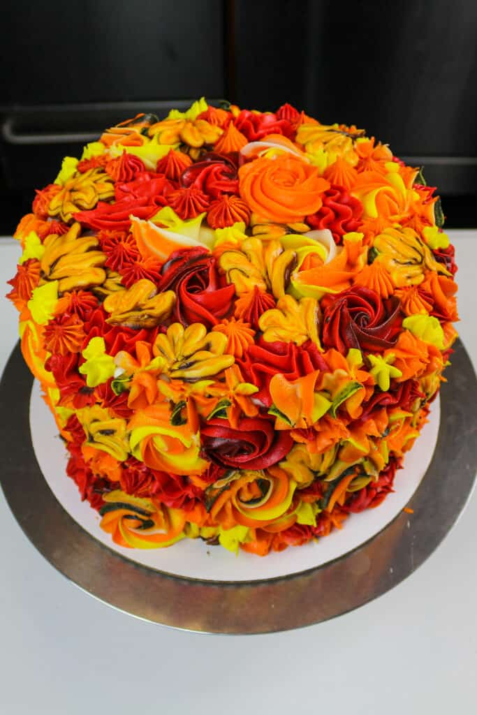 image of a beautiful apple pie layer cake frosting with colorful cinnamon buttercream