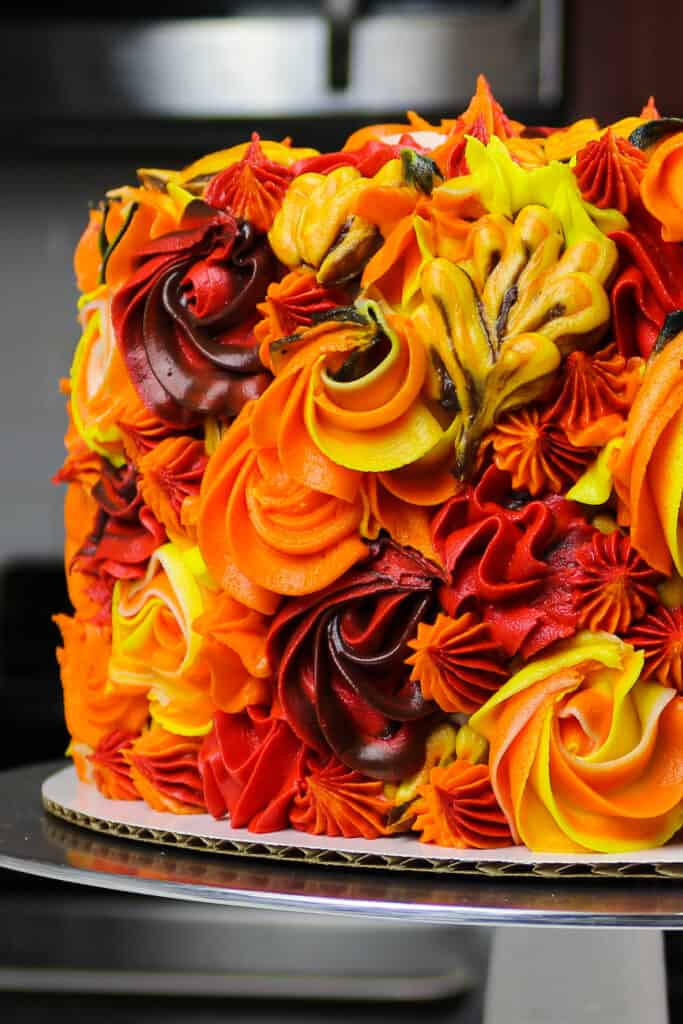 image of a beautiful apple pie layer cake decorated with colorful frosting