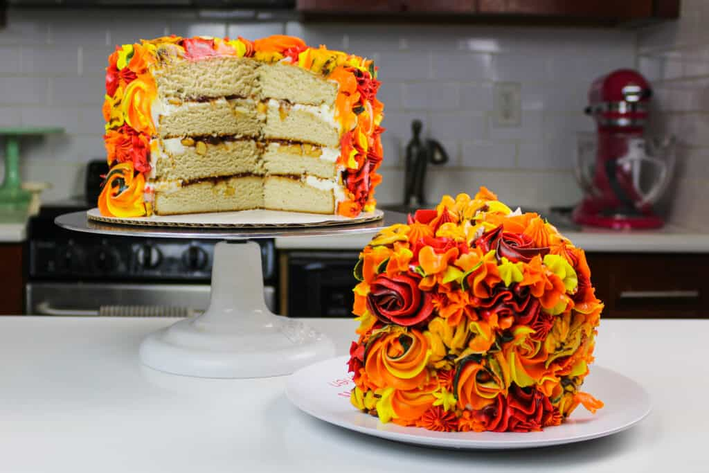 image of an apple pie layer cake that's been cut into to show its delicious apple pie filling.