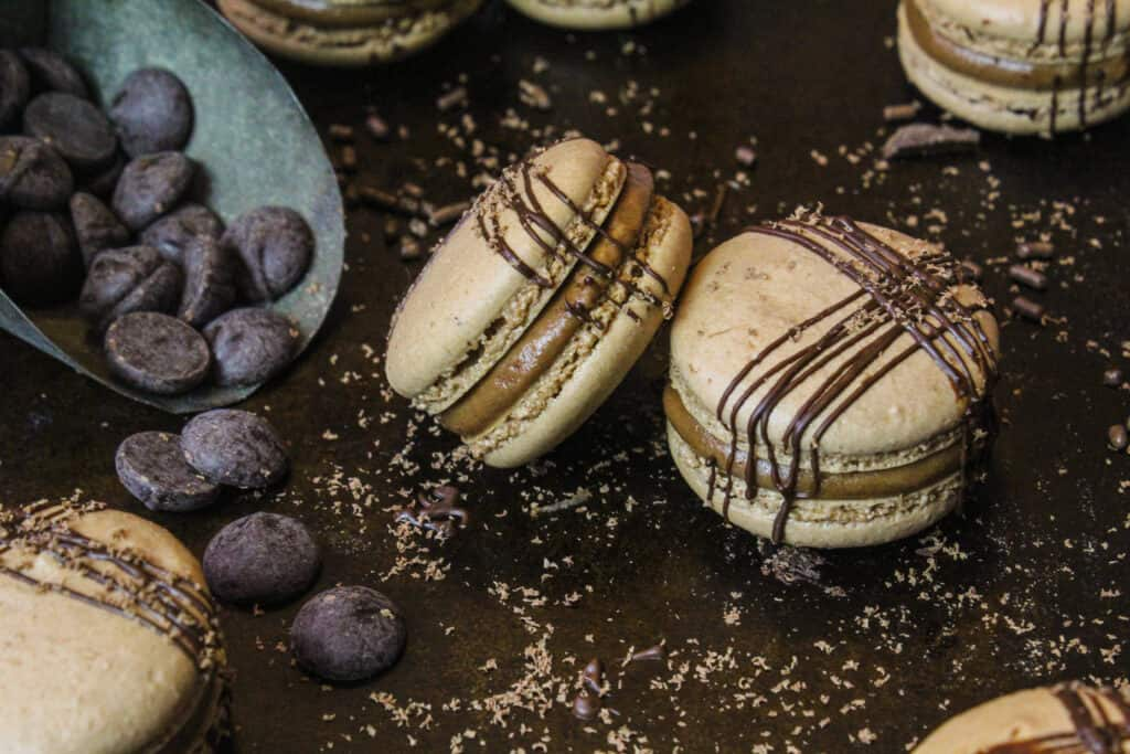 image of french chocolate macarons decorated with a beautiful drizzle of melted chocolate