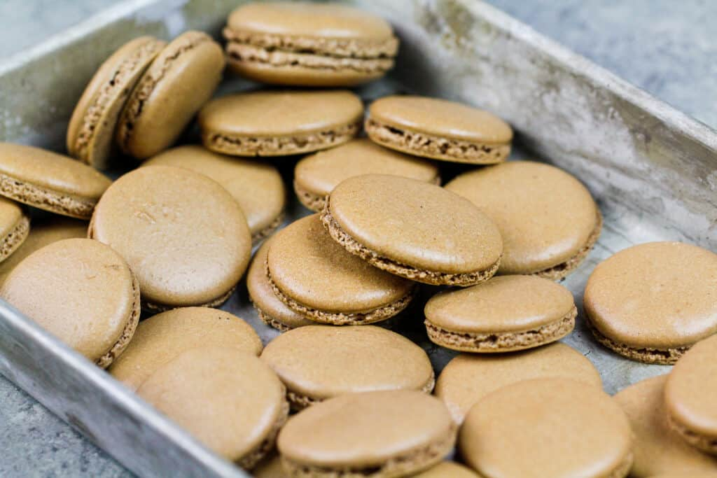 image of chocolate macaron shells that have been baked to make Nutella macarons