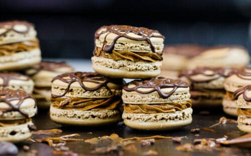 image of Nutella macarons that have been decorated with drizzled chocolate