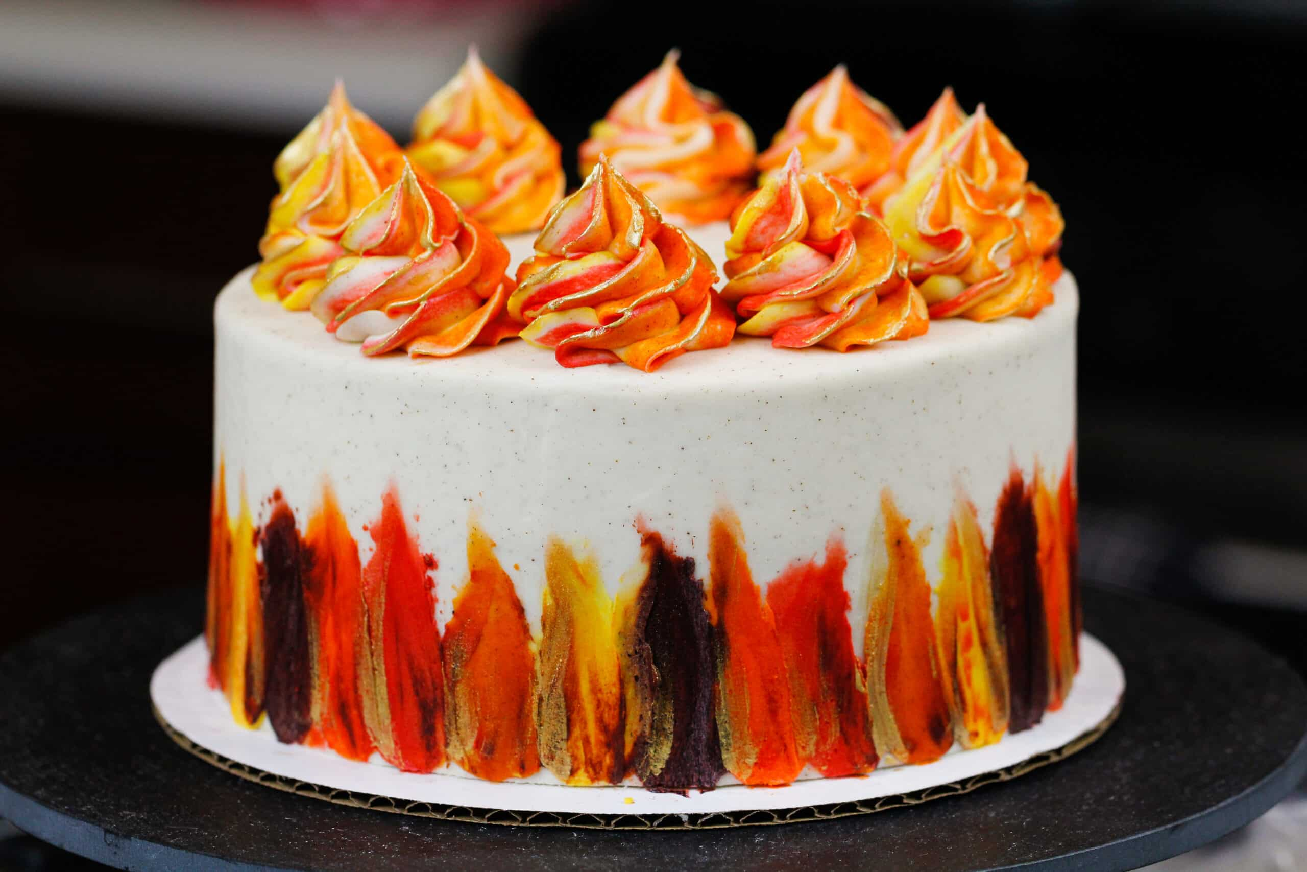 image of a beautiful gluten free spice cake decorated with bright Fall-inspired frosting