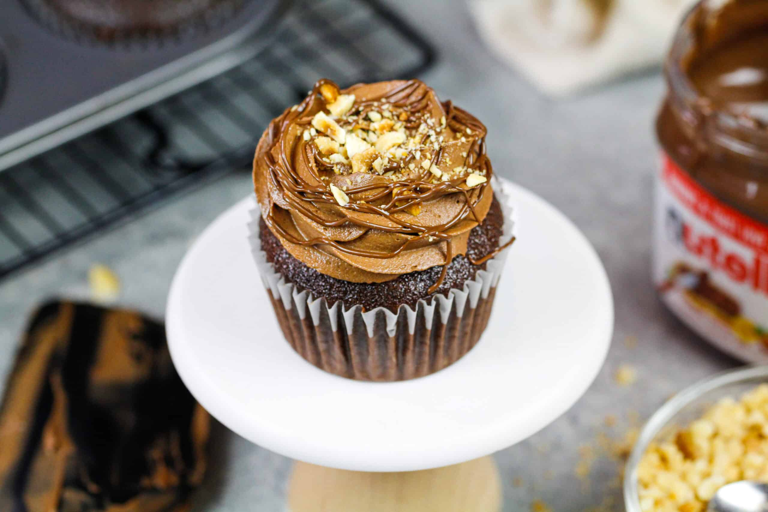 image of a pretty chocolate nutella cupcake decorated and placed on a cute little cupcake stand