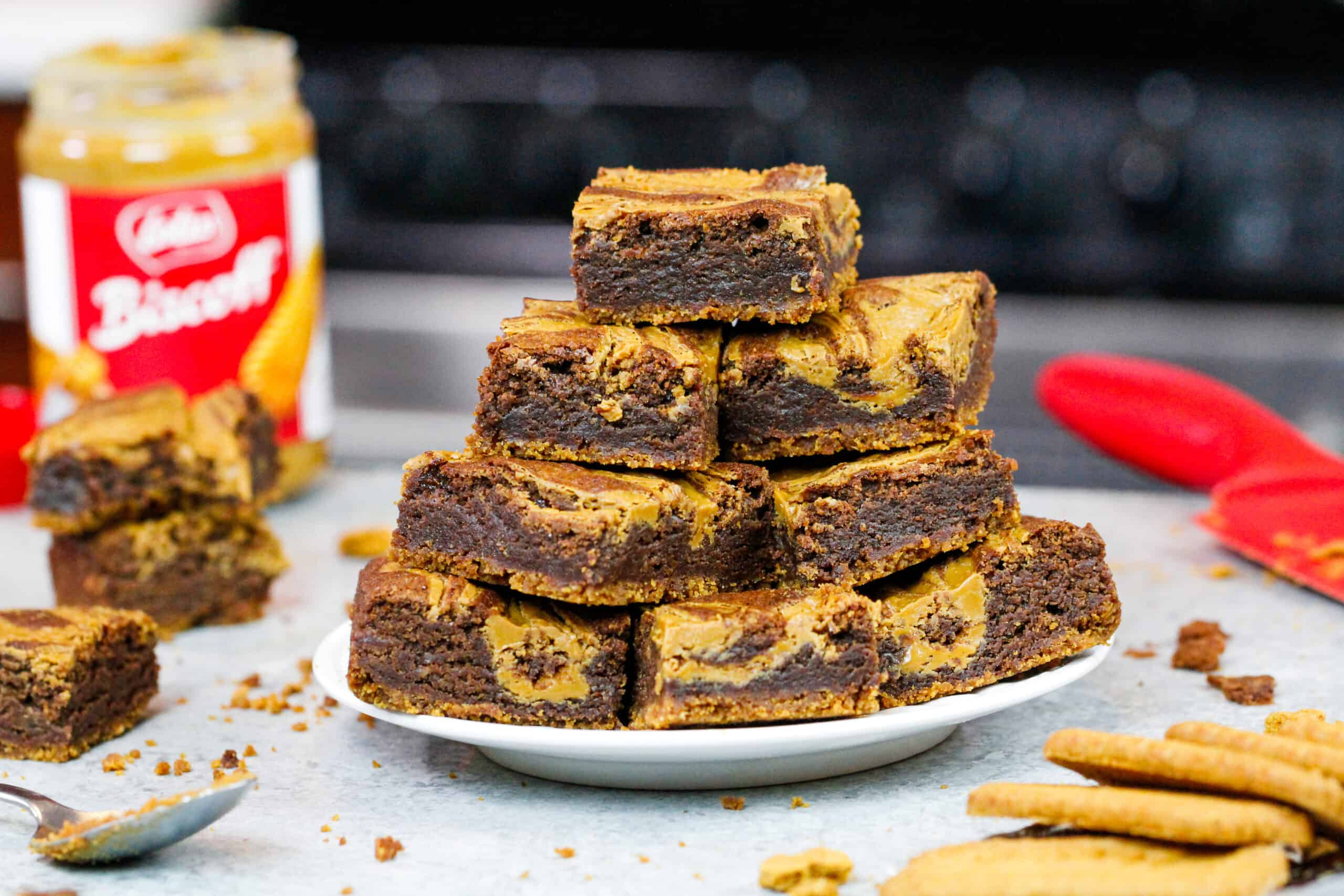 image of biscoff brownies baked and stacked on a plate