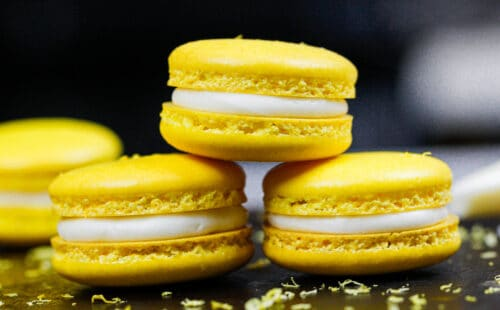 image of french lemon macarons filled with lemon curd and fresh lemon buttercream frosting