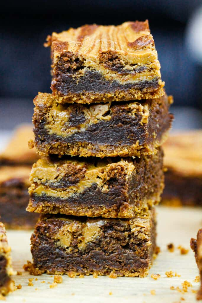 image of biscoff brownies that are stacked on top of each other to show their delicious fudgy texture