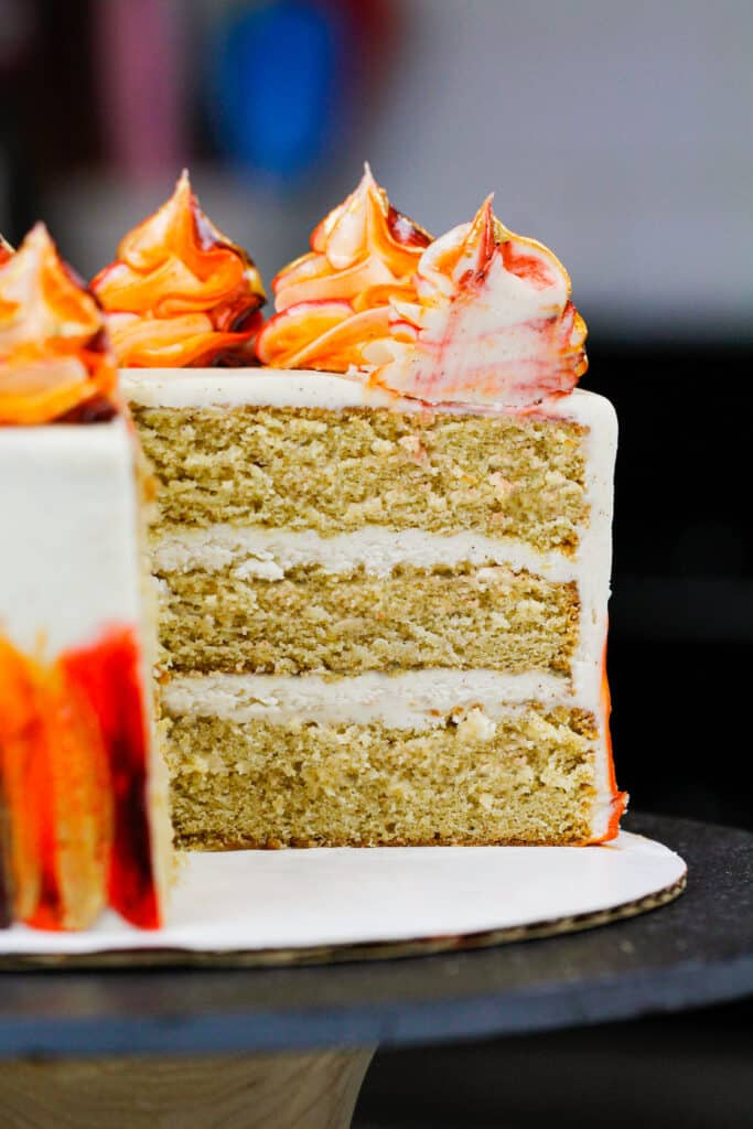 image of a layered spice cake that's been cut into to show the fluffy and tender texture of the cake layers