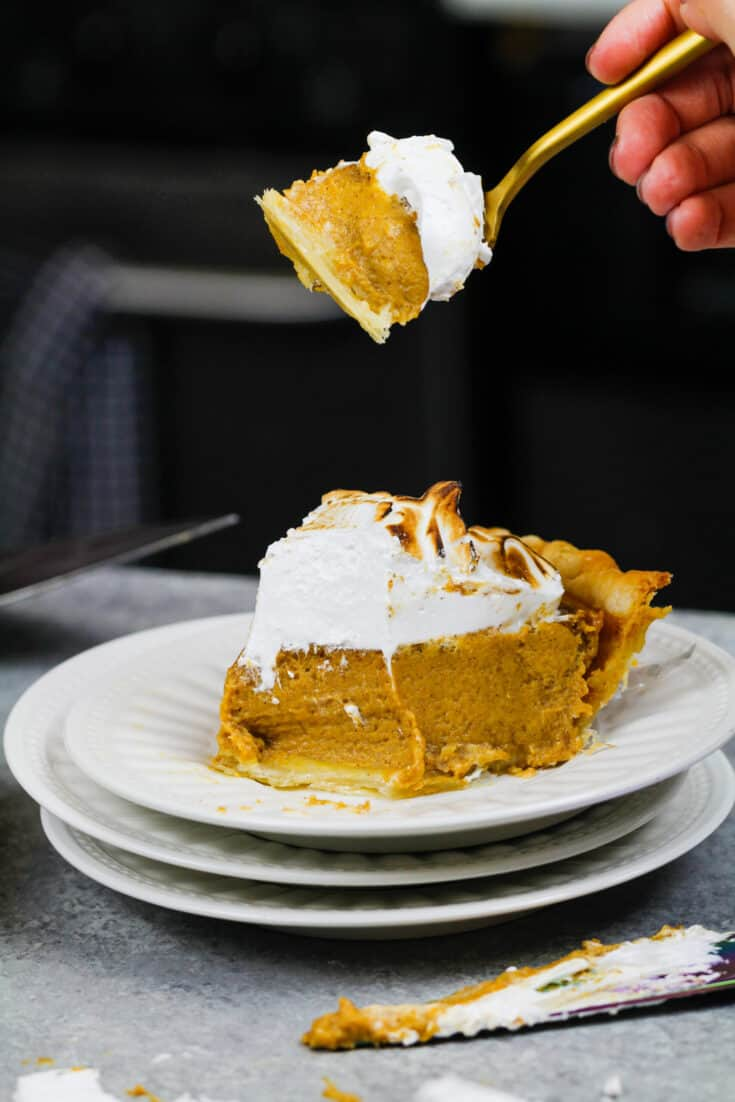 image of a mascarpone pumpkin pie slice that's been cut into to show how creamy it is