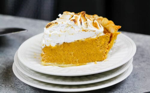 image of a slice of mascarpone pumpkin pie topped with toasted meringue