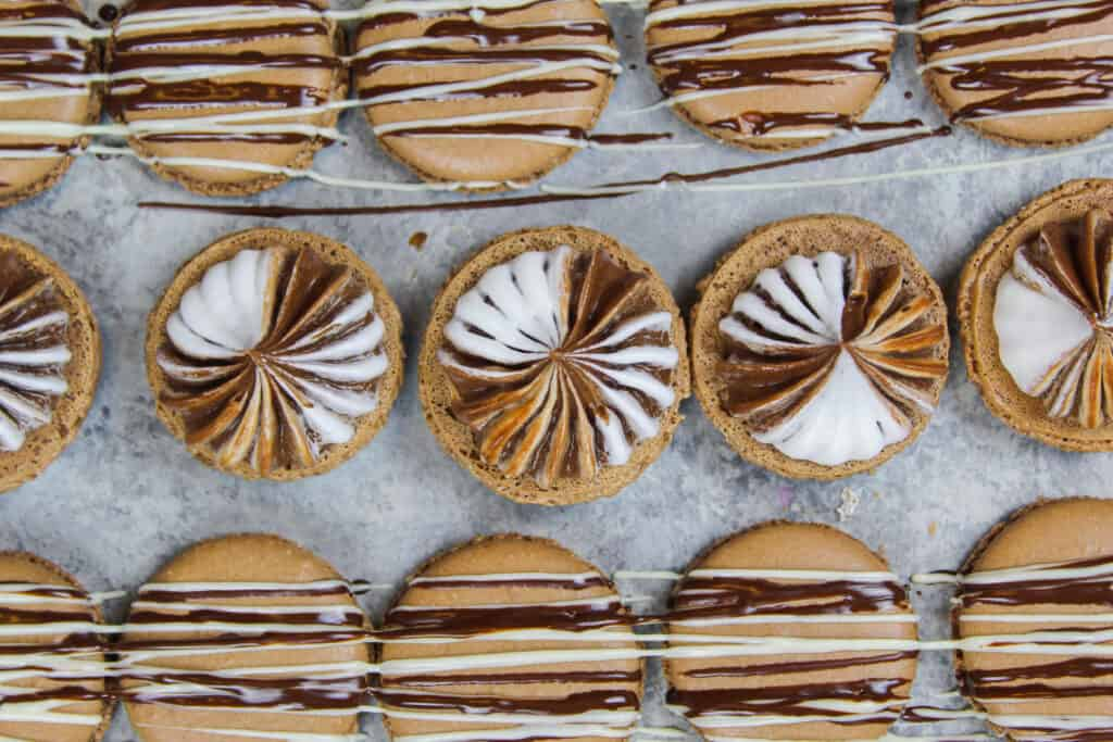 image of hot chocolate macarons filled with marshmallow and hot chocolate buttercreams