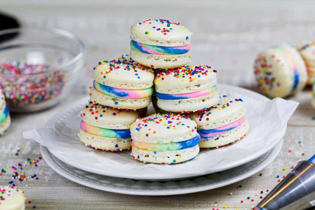 image of rainbow macarons stacked on a plate