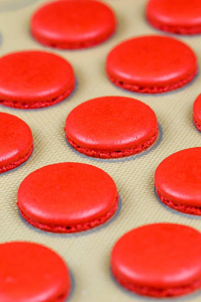 image of baked red velvet macaron shells