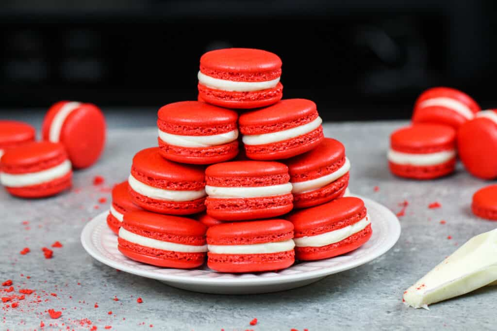 image of red velvet macarons stacked on a plate