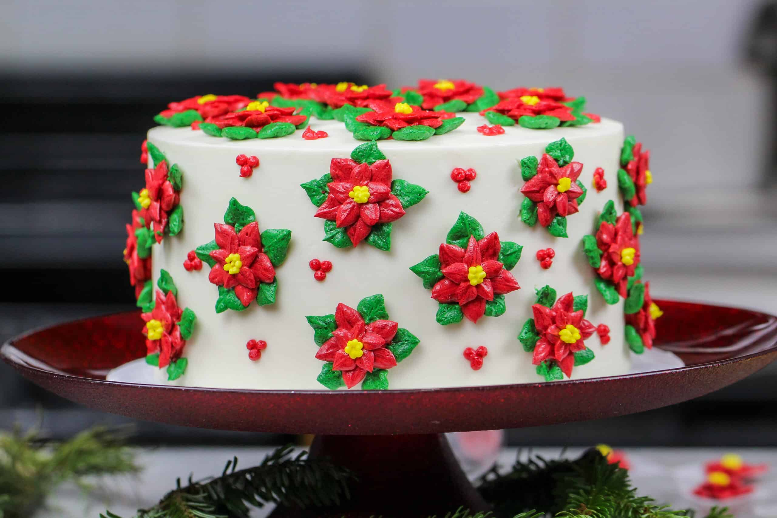 image of poinsettia cake made with red and green buttercream