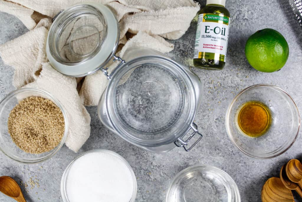 image of ingredients laid out to coconut lime sugar scrub made in a reusable glass jar to be used as a natural exfoliator