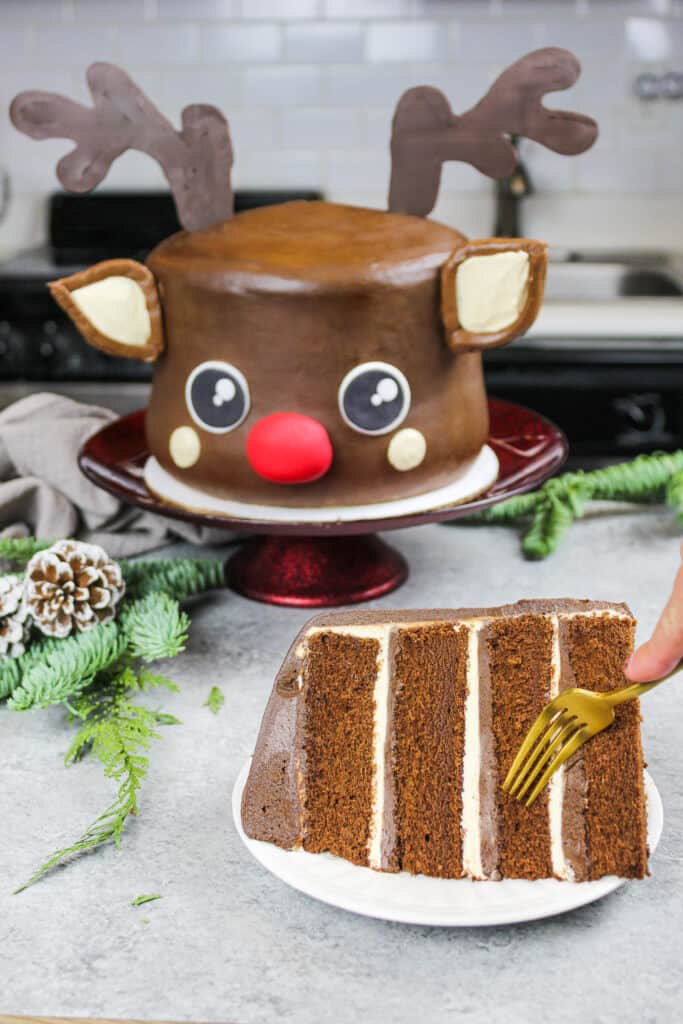 image of a chocolate peanut butter rudolph cake that's been cut into to show how moist and fluffy the cake layers are