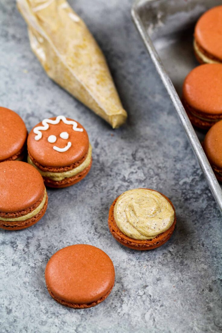 image of a gingerbread macaron frosted with gingerbread buttercream frosting