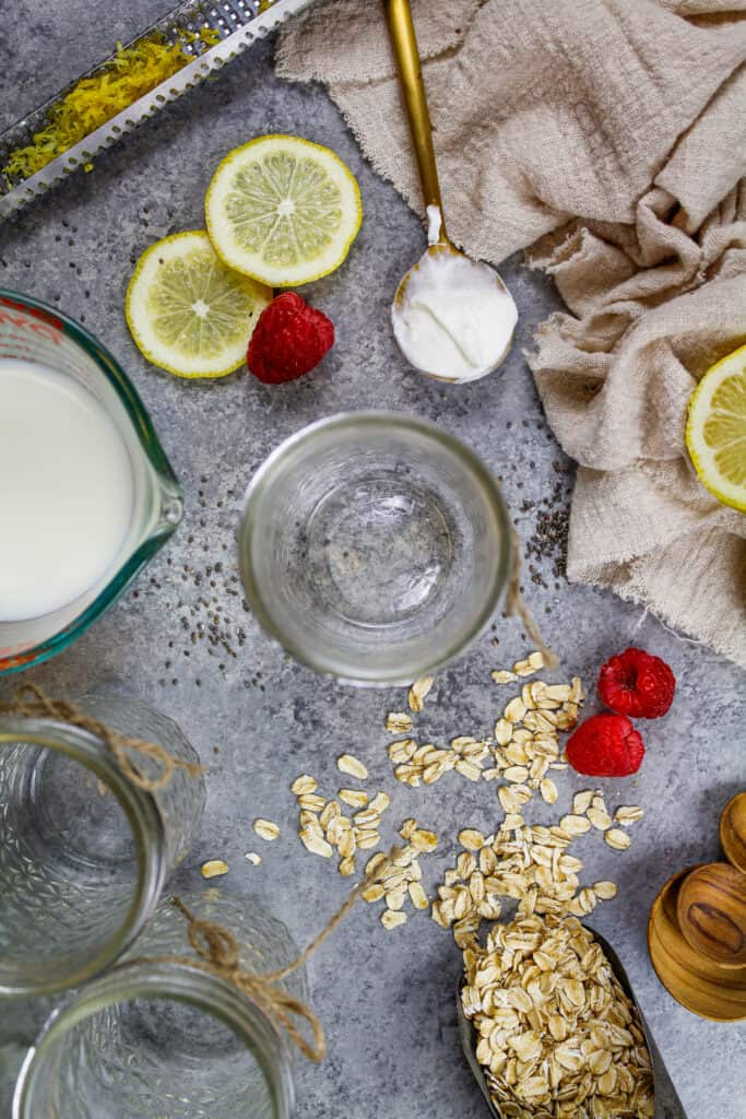 image of ingredients laid out to make a batch of raspberry overnight oats ahead of time