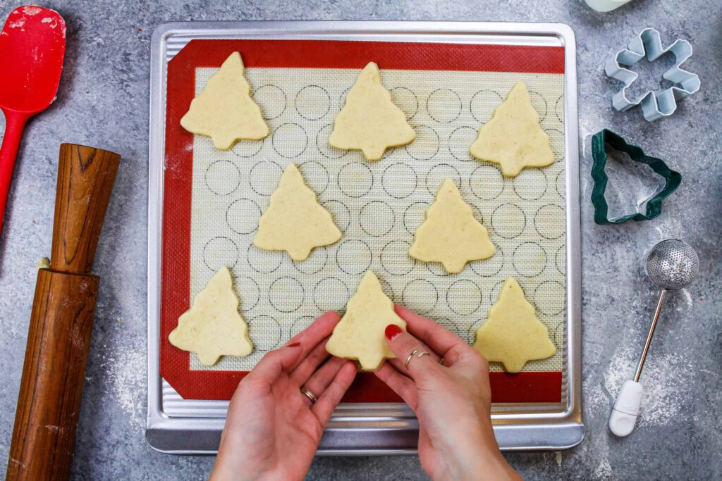image of christmas tree sugar cookies cut out and ready to be baked