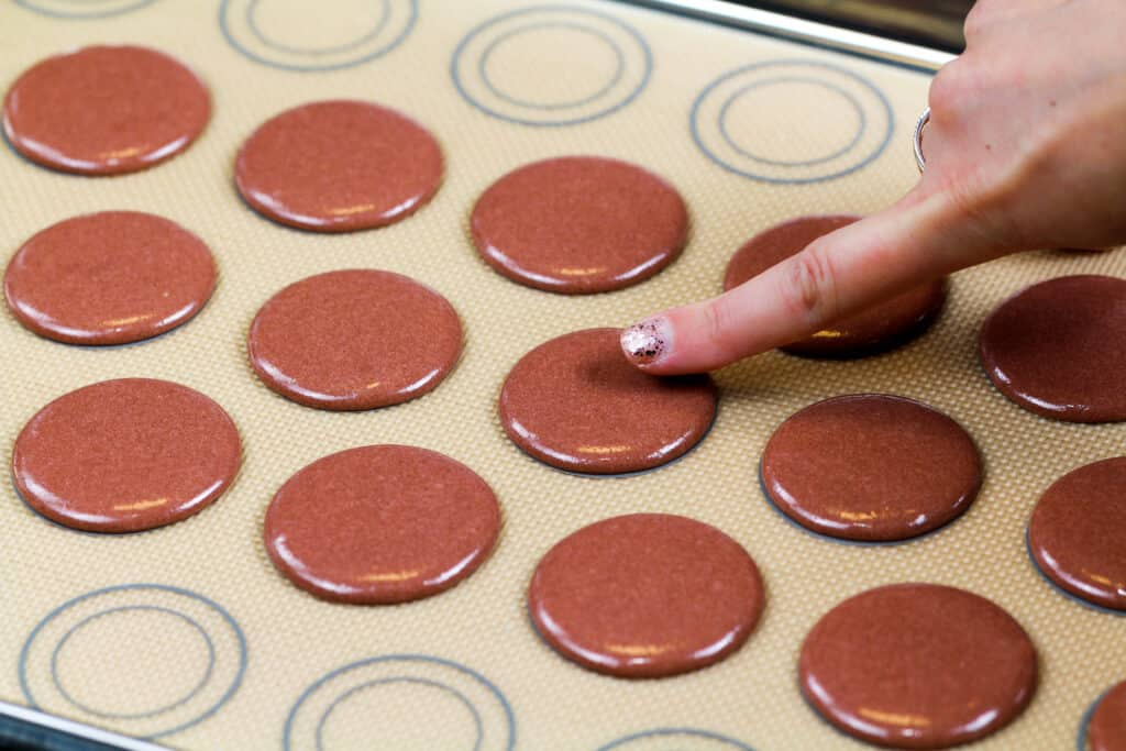 image of brown french macaron shells that have been rested and have formed a skin
