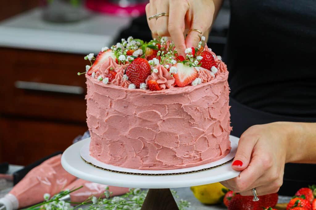 image of vanilla strawberry cake with vanilla cake layers and strawberry buttercream