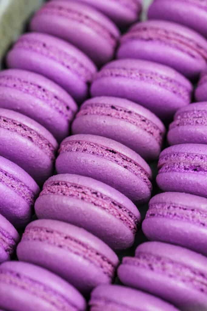 image of purple french macaron shells baked with perfect feet ready to be filled