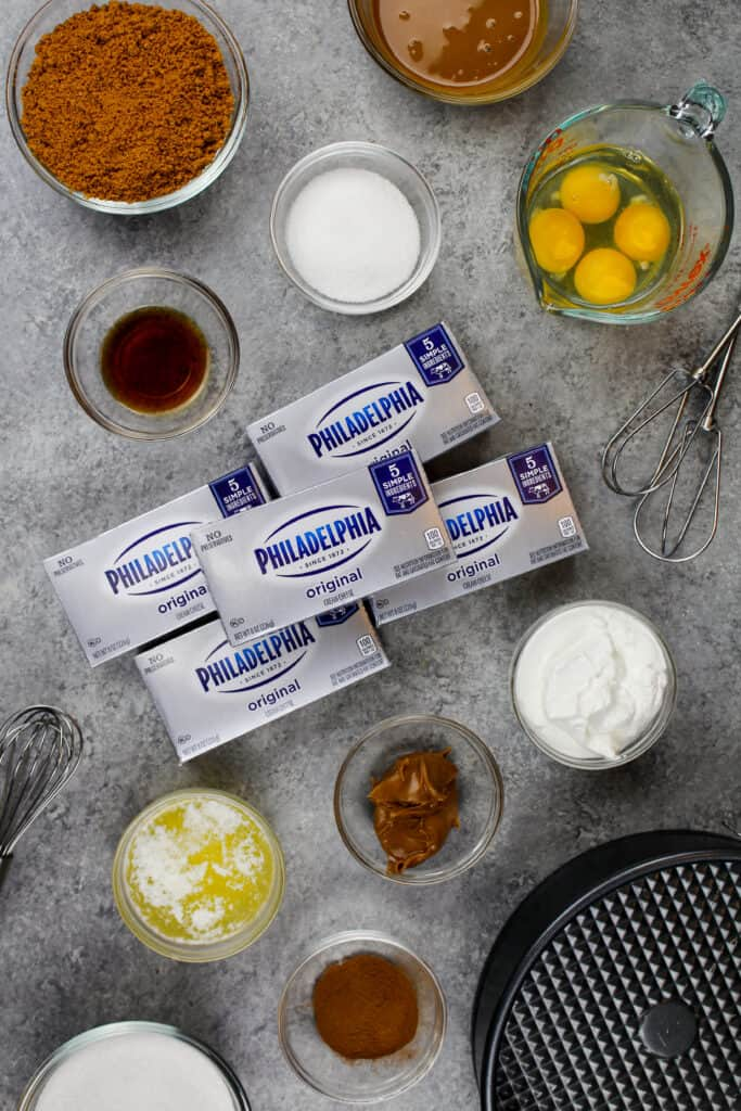 image of ingredients laid out on a counter to make a biscoff cheesecake