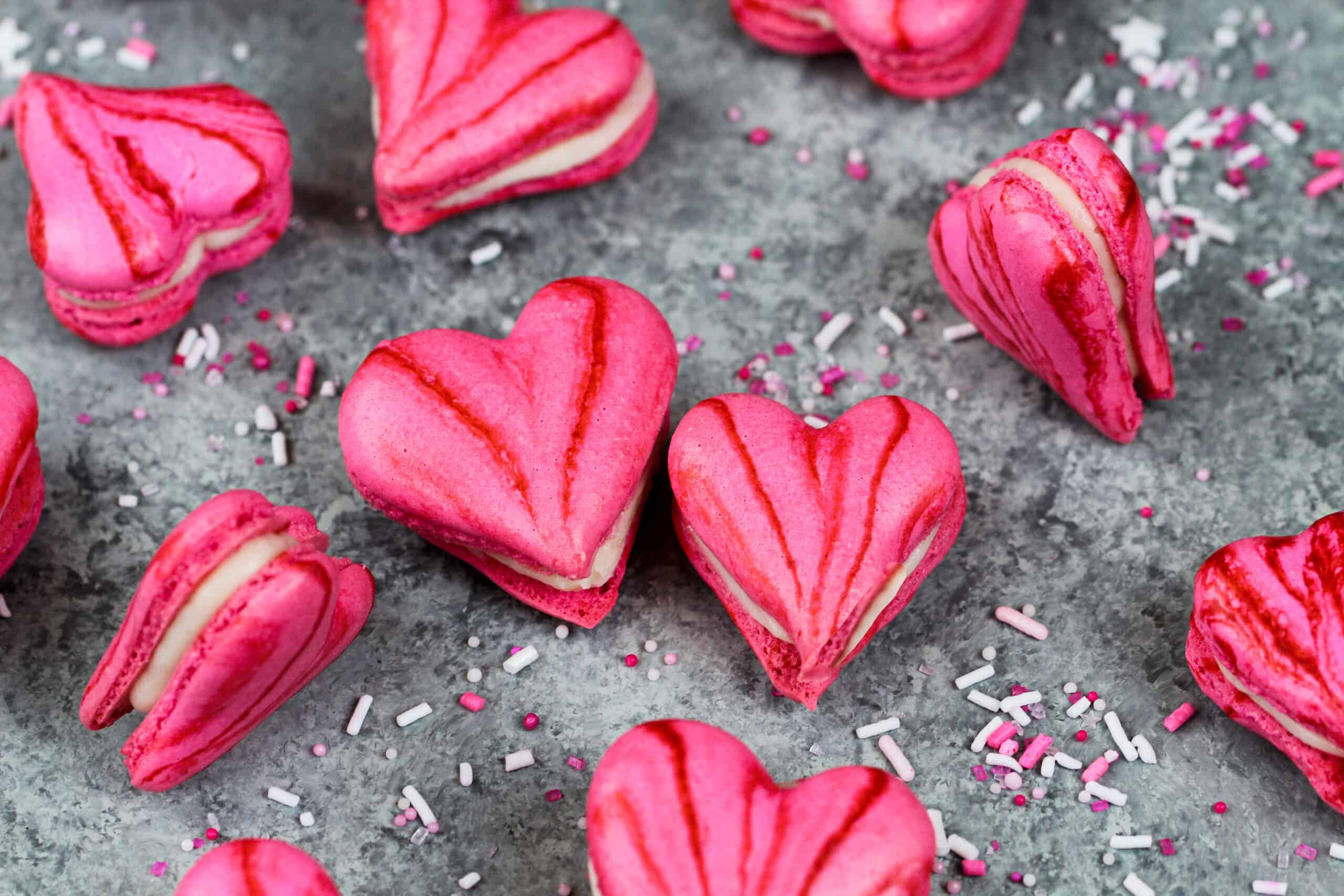 image of pink heart shaped macarons filled with buttercream