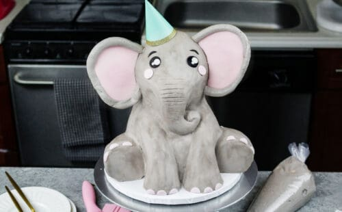 image of an elephant cake made mostly with buttercream and a little pink fondant