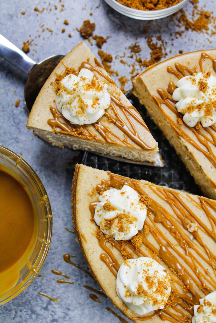image of biscoff cheesecake that's been drizzled with warm cookie butter and topped with whipped cream