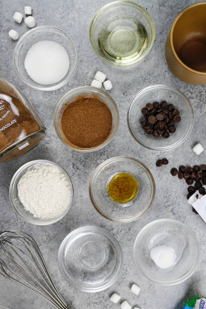 image of ingredients laid out on a counter to make a hot cocoa mug cake