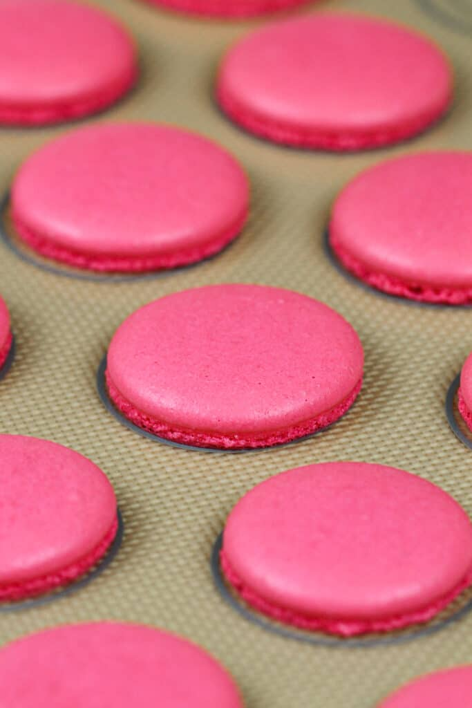 image of pink macaron shells that have been baked with perfect feet to make raspberry macarons