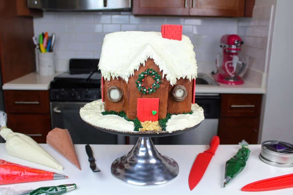 image of a gingerbread house cake frosted with gingerbread buttercream frosting
