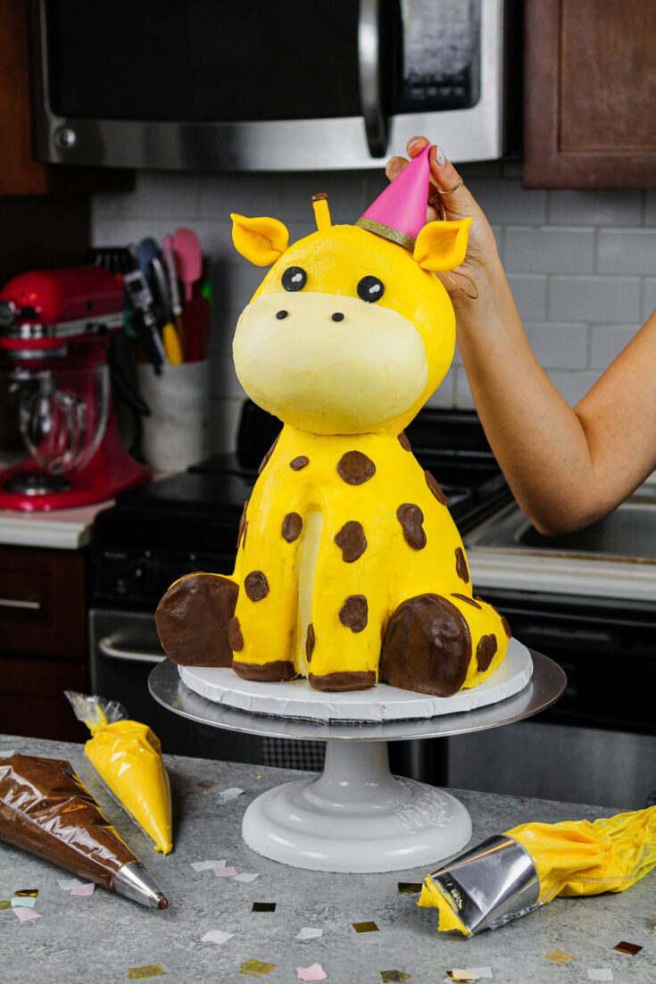 image of a giraffe cake made with buttercream and rice krispies