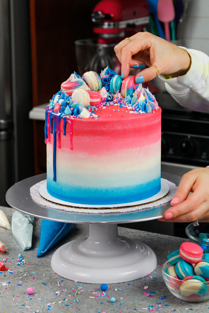 image of a pretty gender reveal cake decorate with blue and pink frosting and customized to celebrate either a boy or girl