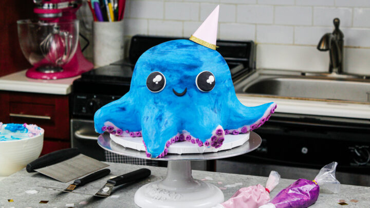 image of an octopus birthday \cake made with colorful cake layers, buttercream and cake decorating rice krispie