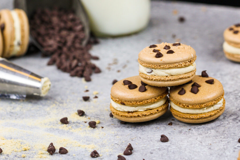 image of cookie dough macarons filled with cookie dough buttercream and mini chocolate chips