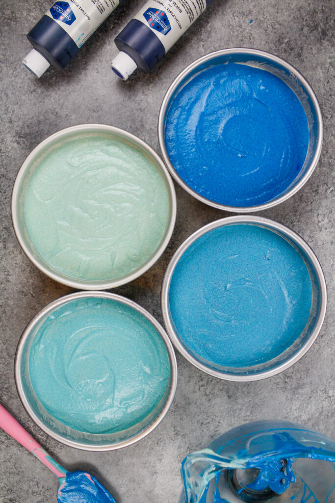 image of ombre blue cake layers ready to be baked